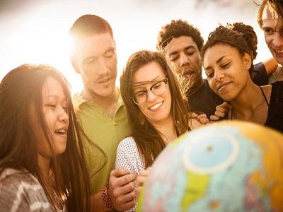international students with globe